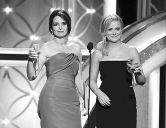 Tina Fey, left, and Amy Poehler toast and host at the 71st Golden Globe Awards on Jan. 12.