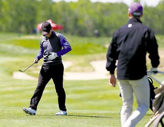 Western University�s Traynor Turkiewicz (top right) shanks a shot from the rough that hits Manitoba�s Josh Wytinck in the abdomen. Observers said the ball would have reached a water hazard had it not nailed Wytinck.