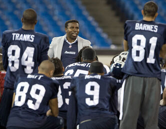 "Former Toronto Argonauts player and coach Michael ""Pinball"" Clemons speaks to the players after their practice on Friday."