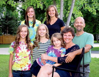 Tracey Herms, with her family. Back row, from left: Michelle, 17, and Katherine, 18. Front row: Heather, 13, Sarah, 15,  Jennifer, 7, Tracey, and her husband, Reinhard.