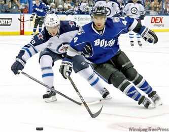 Tampa Bay Lightning centre Nate Thompson (44) loses an edge as he chases the puck against Winnipeg Jets defenceman Tobias Enstrom Saturday.