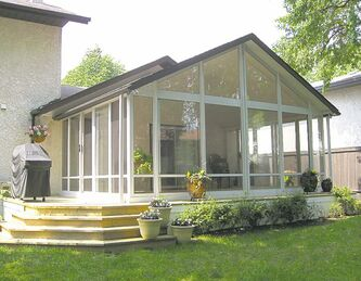 A 14-by-20-foot Glastar three-season  sunroom with gable roof in Charleswood.