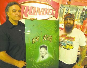 Ontario-based airbrush artist and pinstriper Ron Gibbs, left, aka 'The Canadian Rat Fink,' was at the Rondex booth all weekend doing airbrush and pinstripe demonstrations. Travis Cool of Rondex, right, prepared a panel that Gibbs painted this lifelike portrait of Ed �Big Daddy� Roth on.