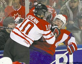 Canada's Brayden Schenn thumps a Norwegian opponent Wednesday. Schenn, who scored four times and added an assist, has 10 points in his last two games.