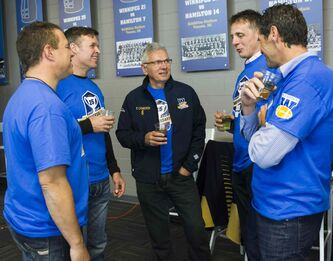 From left: Darren Yewckyn, Paul Clatney, Bob Cameron, Randy Fabi, and Rob Prodanovic catch up during a reunion of the 1988 Grey Cup championship Winnipeg Blue Bombers team, at the Pinnacle Club at Investors Group Field Friday afternoon.