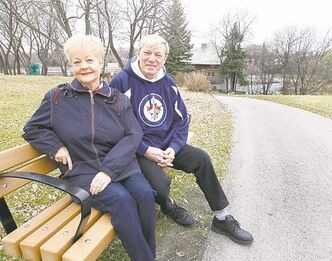 Gail Schell and her husband, Hoss Schell, at a bench near Grant's Mill on Sturgeon Creek.