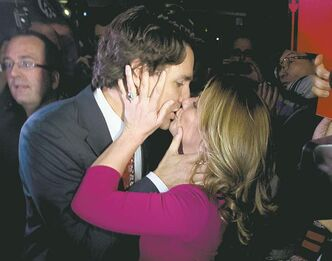 Liberal leadership candidate Justin Trudeau kisses his wife Sophie Gregoire-Trudeau during the 2013 Liberal Leadership National Showcase in Toronto on Saturday.