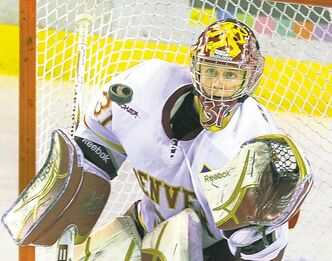Denver goalie Juho Olkinuora made a glove save in the third period Saturday. The University of Denver hockey team was shut out 4-0 by  Minnesota Duluth at Magness Arena Saturday night  Nov. 5, 2011. (AP Photo/Karl Gehring,The Denver Post)