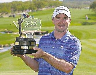 Martin Laird shows his Texas Open trophy. Now, it's on to the Masters.