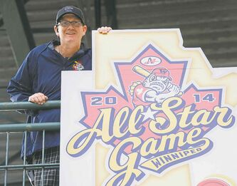 Goldeyes GM Andrew Collier with  the 2014 all-star game banner.