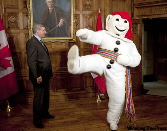 Prime Minister Stephen Harper meets with Bonhomme Carnaval in his office on Parliament Hill in Ottawa on Thursday.