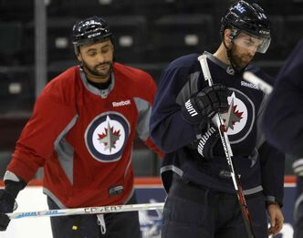 Dustin Byfuglien, left, and Captain Andrew Ladd at practice this morning.