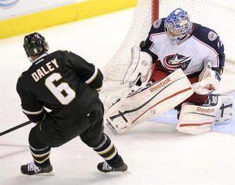Columbus Blue Jackets goalie Sergei Bobrovsky (72) stops a shot by Dallas Stars defenseman Trevor Daley (6) during the third period of an NHL hockey game, Thursday, April 25, 2013, in Dallas. THE CANADIAN PRESS/AP/Matt Strasen