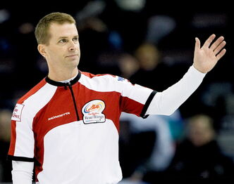 Thank you... thank you very much. Jeff Stoughton waves to the crowd Thursday after a brilliant, 7-6 comeback win over Wayne Middaugh.