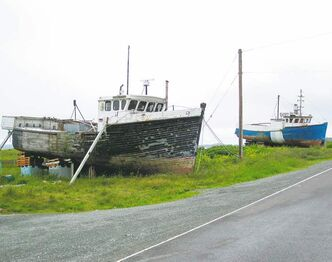 While fish stocks dwindle, lobster fishing still provides important income. Boats docked along the road in the small fishing hamlet of Marie Joseph, two hours east of Halifax.