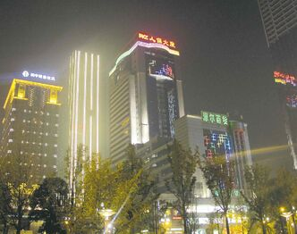 Buildings ringing Tianfu Square in Chengdu put on a light show after dark.