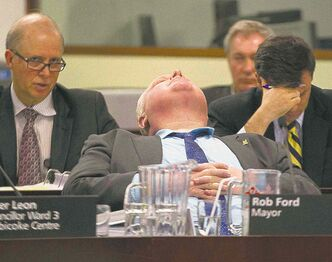 Scandal-plagued Mayor Rob Ford reclines during a committee meeting at Toronto's city hall on Thursday.