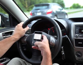Manitoba made using a handheld mobile device illegal three years ago. Currently, the penalty is a $200 fine.