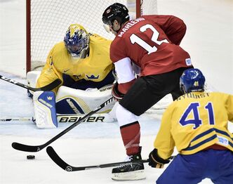 Canada forward Patrick Marleau looks to shoot against Sweden goalie Henrik Lundqvist during third period action in the gold medal game at the 2014 Sochi Winter Olympics in Sochi, Russsia, on Sunday, February 23, 2014. THE CANADIAN PRESS/Nathan Denette