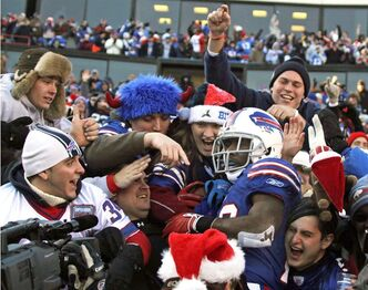 Buffalo Bills' C. J. Spiller (28) celebrates his touchdown with fans during the first half of an NFL football game against the Denver Broncos in Orchard Park, N.Y., Saturday, Dec. 24, 2011. (AP Photo/Gary Wiepert)