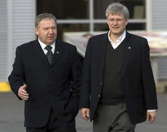 Prime Minister Stephen Harper walks with Nova Scotia Premier Darrell Dexter, left, on the dock at the marine terminal in Sydney, N.S. on Friday, Dec. 10, 2010. Dexter says he'll talk to Stephen Harper this week about changing the criminal code in response to the death of 17-year-old Rehtaeh Parsons.THE CANADIAN PRESS/Andrew Vaughan