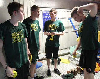Thomas Osborn, far right, prepares to compete in the 200 metre medley relay at the 2013 Manitoba/Saskatchewan Short Course swimming championships in Regina, Saskatchewan.