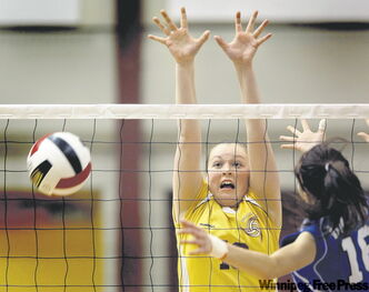 Crocus Plains' Jessica McCharles blocks Lord Selkirk's Marlee Webster in Thursday's semifinal match.