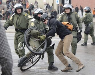 A protester clashes with police during a demonstration by students in Montreal, Tuesday, Feb.26, 2013. THE CANADIAN PRESS/Ryan Remiorz