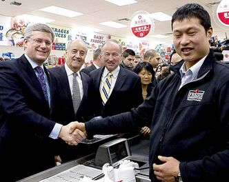 From left: Prime Minister Stephen Harper, Minister of State for Seniors Julian Fantino, Justice Minister Rob Nicholson and David Chen at his Toronto store.
