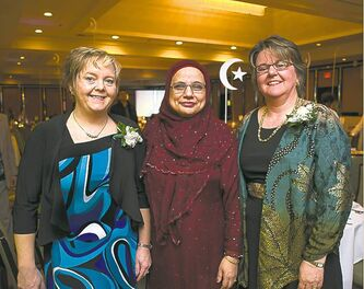 Shahina Siddiqui is flanked by the FP's Carol Sanders (left), Brenda Suderman.