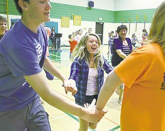 Students swing each other around during the dance.