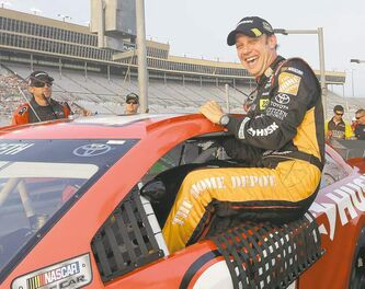 Sprint Cup Series driver Matt Kenseth (20) climbs out of his car after qualifying for Sunday�s Advocare 500 NASCAR auto race at Atlanta Motor Speedway in Hampton, Ga., Friday, Aug. 30, 2013. (AP Photo/John Bazemore)