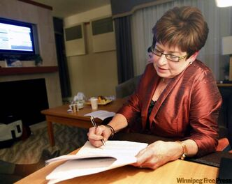Judy Wasylycia-Leis works on one of her two possible speeches last night.