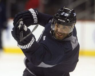Defenceman Johnny Oduya practices his shot from the point during a light game-day workout at the MTS Centre.