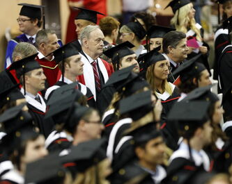 Jean Chretien enters the the Duckworth Centre with students and the academic procession Thursday.
