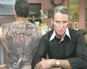 Mark Mahoney, right, famed tattoo artist, in his studio in West Hollywood. He counts Johnny Depp and Mickey Rourke among his clients.
