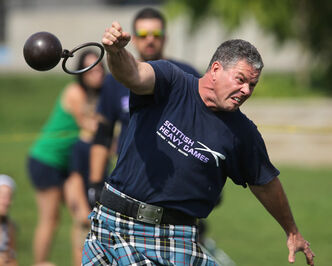 Dean Richards throws the Light Weight for Distance (28 lbs.) during a demonstration of Highland Games at the Forks, Sunday. Lord Selkirk, James Alexander Douglas Hamilton, was participating in a Scottish event that kicks off a week of events commemorating the bicentennial of when his ancestor, along with settlers from Scotland, arrived in Manitoba.