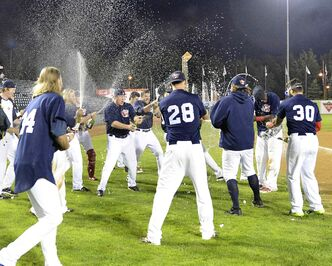 Winnipeg players whoop it up after clinching the North Division title on Friday night.