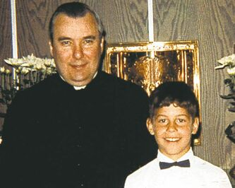 Father Lawrence Murphy with a victim.