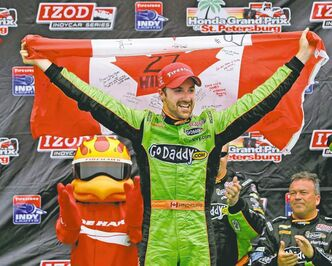 James Hinchcliffe, of Oakville, Ont., celebrates in Victory Circle after winning the IndyCar series Honda Grand Prix of St. Petersburg on Sunday. He held on to beat defending champion Helio Castroneves.