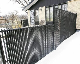 The controversial fence that was allowed to stay at 1001 Day St in Transcona.