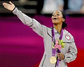 Gabrielle Douglas celebrates at the London Olympics.