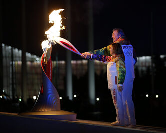 Irina Rodnina and Vladislav Tretiak light the Olympic cauldron during the opening ceremony at the 2014 Winter Olympics in Sochi, Russia.