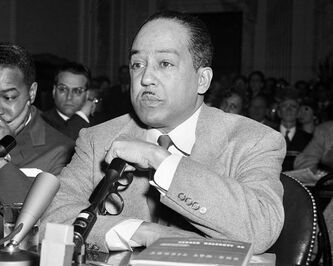 FILE - This March 26, 1953 file photo shows poet and author Langston Hughes speaking before the House Un-American Activities Committee (HUAC) in Washington, D.C. Hughes, Adrienne Rich, Allen Ginsberg, and Wallace Stevens are among the poets whose work recently became available in electronic format. Random House Inc., W.W. Norton and several other publishers now routinely release new books in both print and digital versions. (AP Photo, file)
