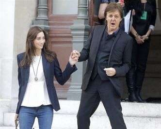 FILE - In this Monday, Oct.1, 2012 file photo Sir Paul McCartney and his wife Nancy Shevell leave after the presentation of his daughter British fashion designer Stella McCartney's ready to wear Spring-Summer 2013 collection, in Paris. McCartney remains Britain's wealthiest musician, according to the Sunday Times Rich List. The newspaper estimated Thursday April 11, 2013 that the ex-Beatle shares a 680 million pound ($1.05 billion) fortune with his third wife, Nancy Shevell, whose family owns a U.S. trucking company. McCartney has topped the musicians' list every year since it was first compiled in 1989.(AP Photo/Michel Euler, File)