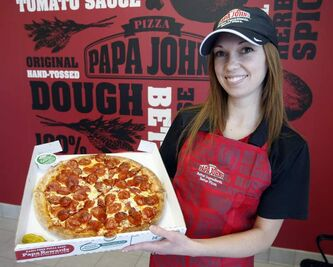 Erin Macdonald, co-owner of Papa John's shows her shop's wares.
