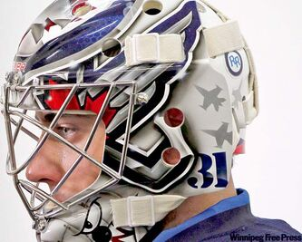 Goalie Ondrej Pavelec's helmet displays the 'RR' in memory of Rypien.