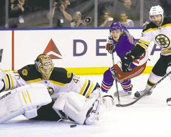 New York Rangers' Carl Hagelin watches as his weak shot eludes falling Boston Bruins goalie Tuukka Rask in  Game 4.
