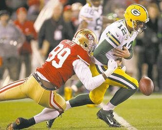 49ers quarterback Colin Kaepernick (above) shredded the Green Bay defence in the air and on the ground. Packers pivot Aaron Rodgers (left) didnt have nearly the same luck, though he did recover this fumble and  gain nine yards on the play.