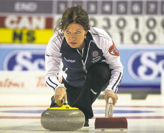 Nova Scotia curler Colleen Jones makes a shot in a 7-6 loss to Team Canada Sunday. Her rink is winless in four tries.